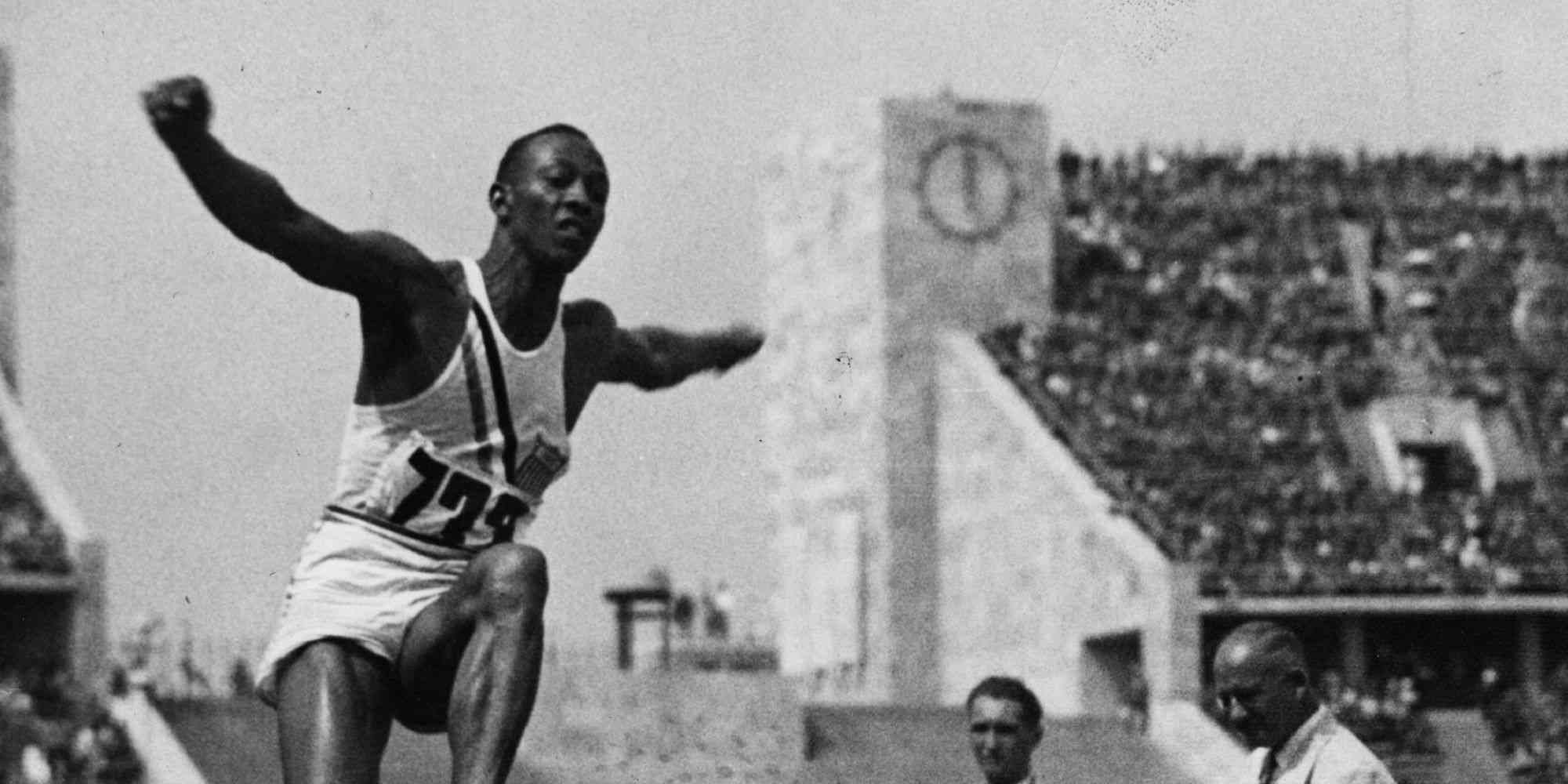 Athlete Jesse Owens (1913 - 1980) flies through the air during the long jump event at the Olympic Games in Berlin. He won 4 gold medals and Hitler left the stadium to avoid having to congratulate a black competitor.